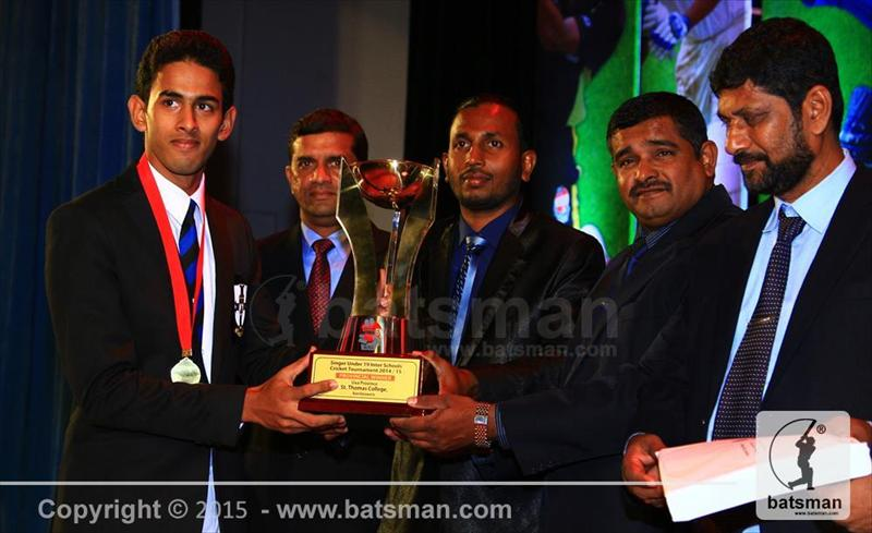 H.N.D. Liyanage of STC Bandarawela receiving the award for the best cricket team in the Uva province